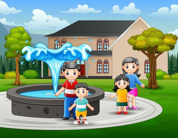 Família feliz brincando perto da fonte