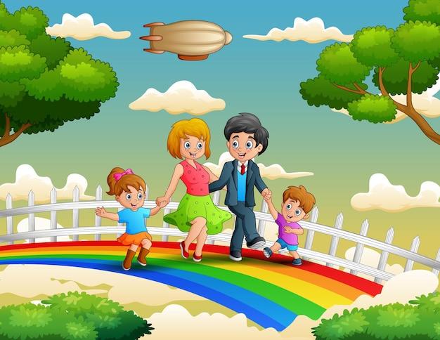 Família feliz caminhando sobre o colorido arco-íris