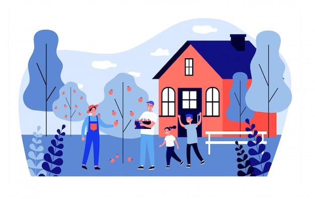 Família feliz colhendo maçãs