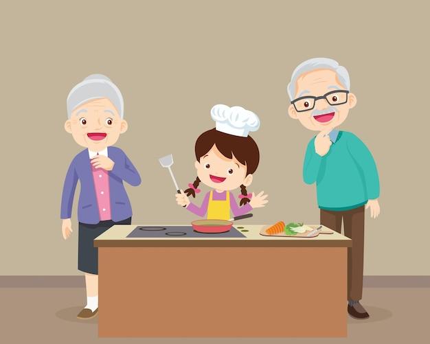 Família feliz com avô e neto cozinhando na cozinha