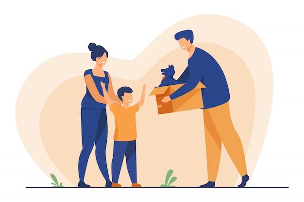 Família feliz com criança adotando animal de estimação
