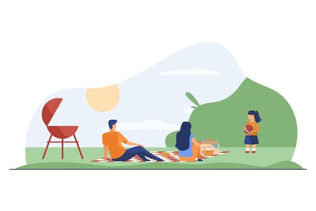 Família feliz com criança relaxando na natureza