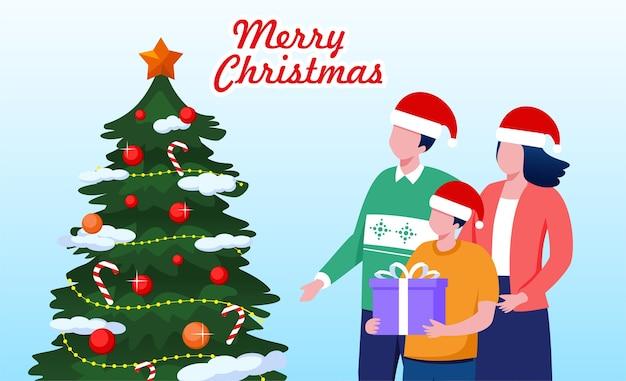 Família feliz com decoração de árvore de natal