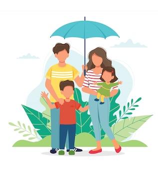 Família feliz com um guarda-chuva