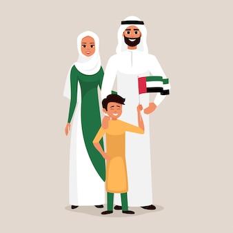 Família feliz, comemorando o dia da independência nos emirados árabes unidos