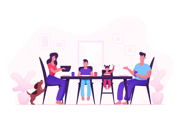 Família feliz de mãe, pai e filhos pequenos jantando à mesa com comida