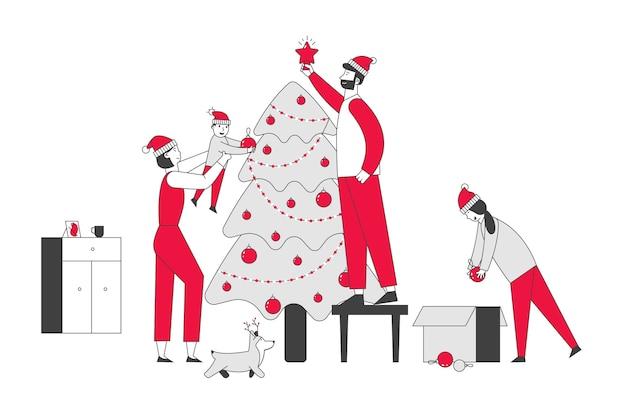 Família feliz decora a árvore de natal