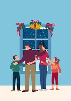 Família feliz em frente à janela durante o inverno