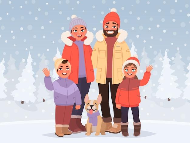 Família feliz em um fundo de uma paisagem de inverno nevado. pais e filhos ao ar livre. férias ativas na estação fria.