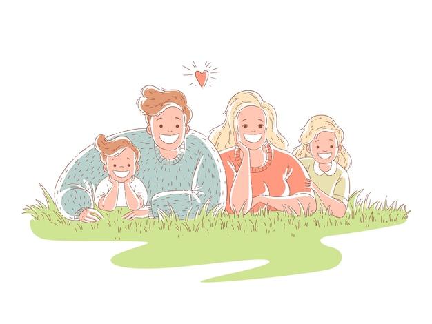 Família feliz está deitada na grama. os pais passam tempo com os filhos.