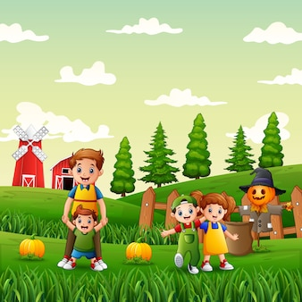 Família feliz no jardim de abóboras
