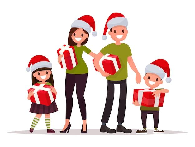 Família feliz no natal com presentes.
