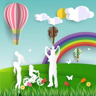 Família feliz se divertindo paisagem natureza e arco-íris