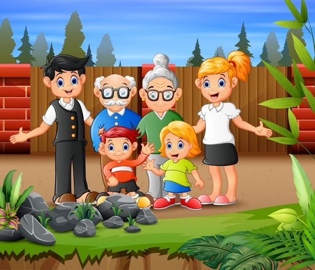 Família grande feliz, acenando a mão no parque