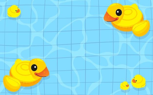Família inflável de pato de borracha amarela flutuando na água