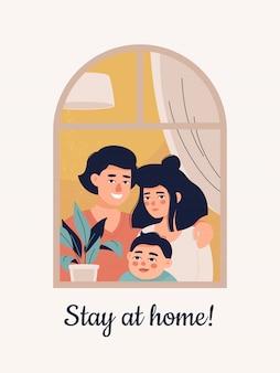 Família jovem com uma criança fica na janela em casa