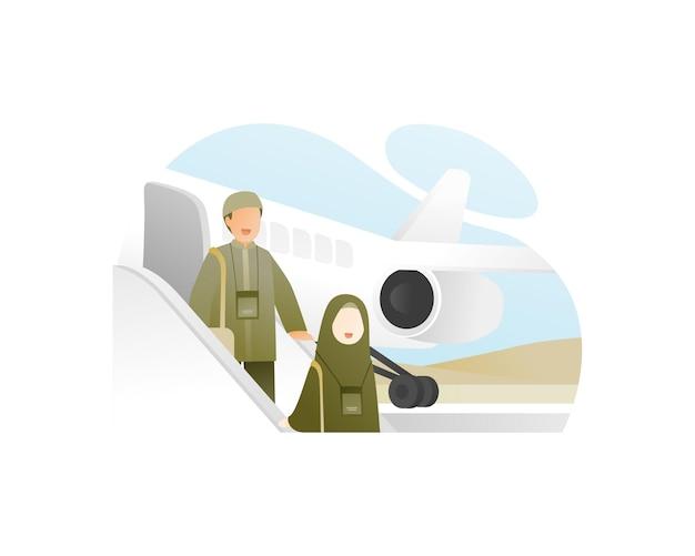 Família muçulmana sai do avião para fazer o hajj em meca