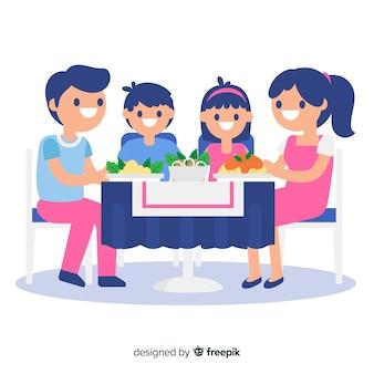 Família plana ao redor da mesa