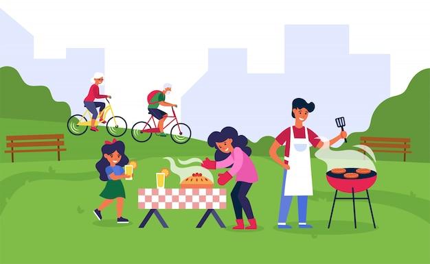 Família tendo churrasco em parque público