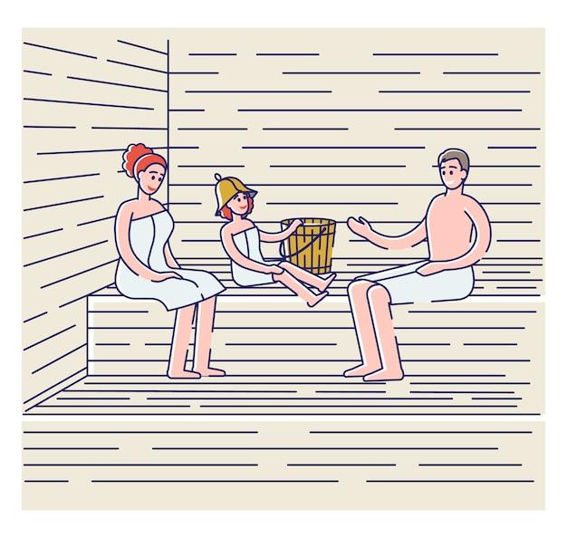 Família tomando banho na sauna finlandesa ou banya russa. pais com criança em toalhas relaxando no spa