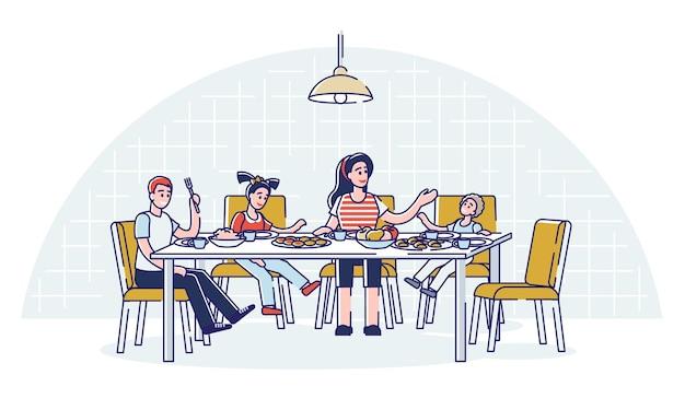 Família tomando café da manhã ou jantar juntos
