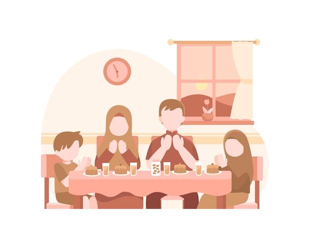 Famílias muçulmanas oram na hora de iftar