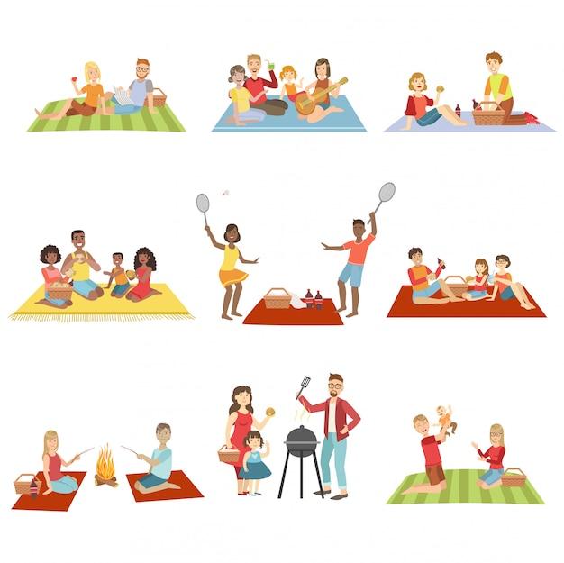 Famílias no piquenique ao ar livre