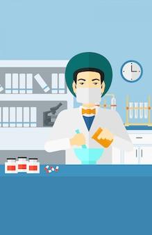Farmacêutico, preparando o medicamento.