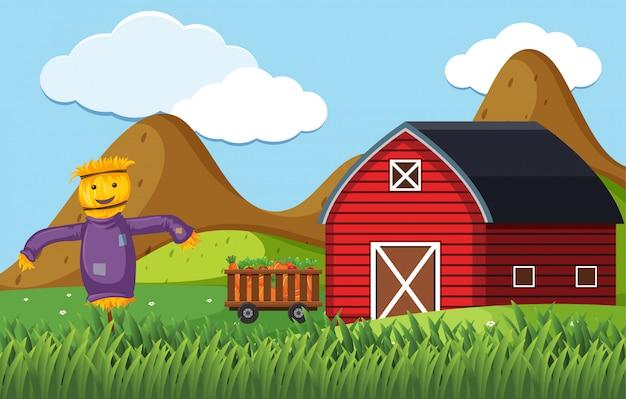 Farmscarecrow e celeiro vermelho
