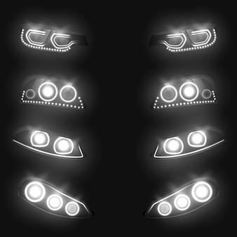 Faróis dianteiros e traseiros do carro que incandescem branco no jogo realístico da escuridão isolado no fundo preto.