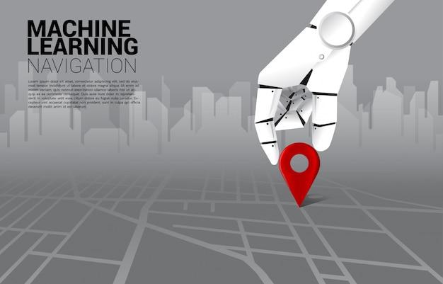 Feche acima da mão do marcador do pino do lugar do lugar do robô no mapa de estradas. conceito de ai aprendendo máquina e sistema de navegação.