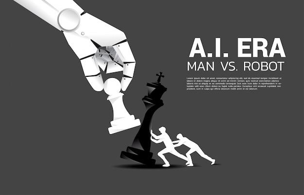 Feche acima da tentativa da mão do robô ao jogo de xadrez do checkmate do ser humano. conceito de ai disruption e homem vs machine learning