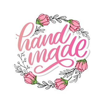 Feito à mão. letras de mão elegante em grinalda floral Vetor Premium