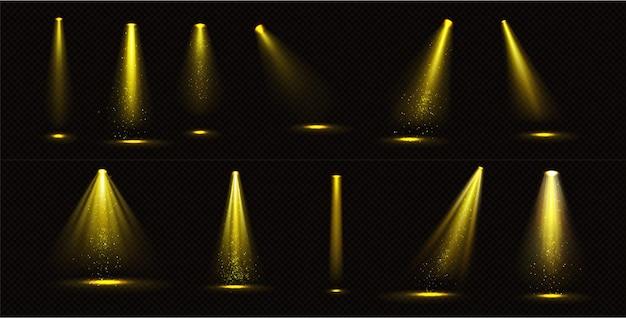 Feixes de holofotes amarelos com brilhos dourados