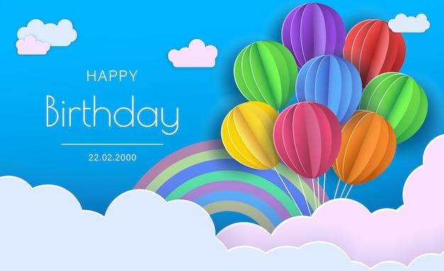 Feliz aniversário. balões nas nuvens. papel e artesanato
