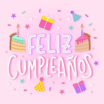 Feliz aniversário em letras espanholas com bolo