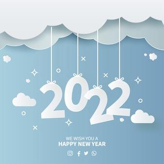 Feliz ano novo 2022 background com papercut desing