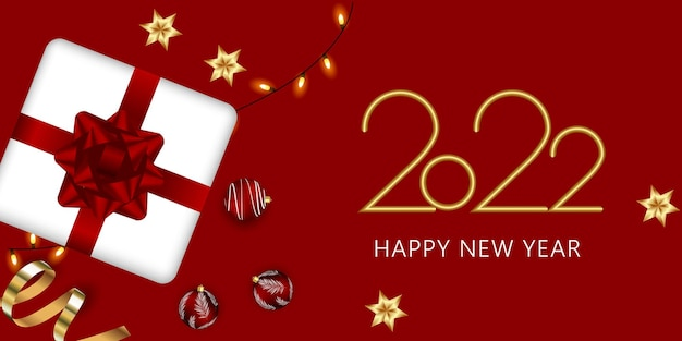 Feliz ano novo 2022 texto dourado elegante com presente e confetes.