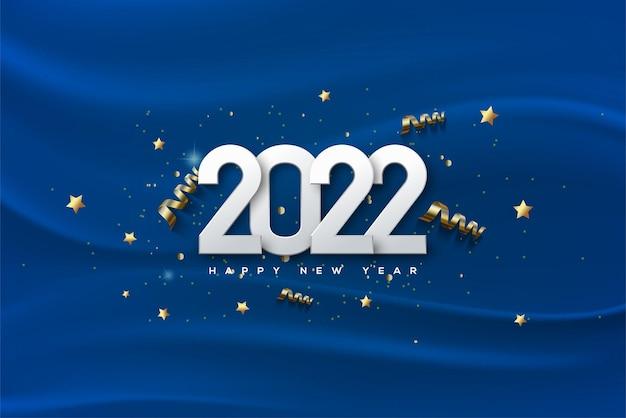 Feliz ano novo de 2022 com números brancos em um fundo de pano azul