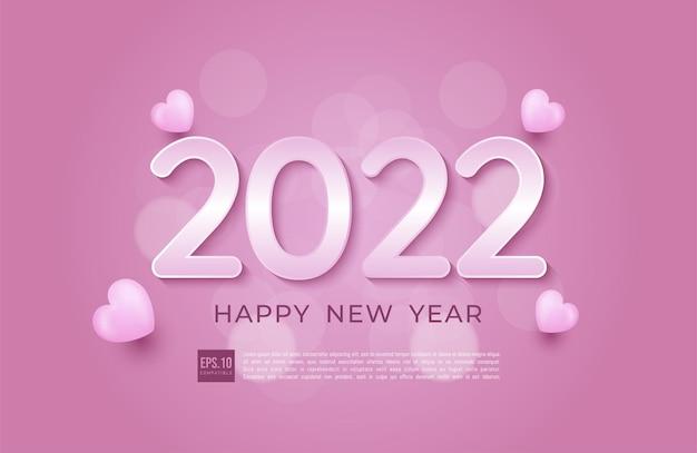 Feliz ano novo de 2022 com tema rosa suave e corações de ícones