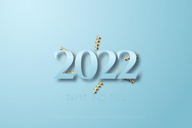 Feliz ano novo de 2022 em fundo azul e fita dourada