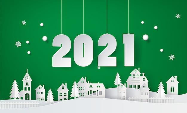 Feliz ano novo e temporada de inverno, aldeia urbana de paisagem urbana de neve com arte em papel de texto e estilo de artesanato.