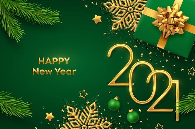 Feliz ano novo, números metálicos dourados com caixa de presente brilhante galhos de pinheiro de floco de neve