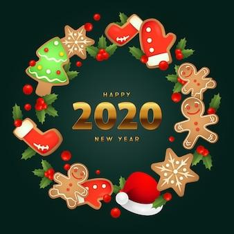Feliz ano novo pão de gengibre guirlanda de natal no chão verde