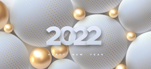 Feliz ano novo sinal de 2022 com bolas douradas e brancas