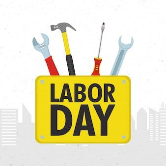 Feliz celebração do dia do trabalho com conjunto de ferramentas Vetor Premium