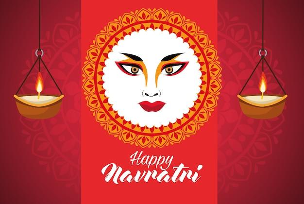 Feliz celebração navratri com o rosto da deusa amba e velas.