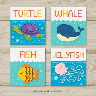 Feliz coleção de cartas com lindos animais do mar