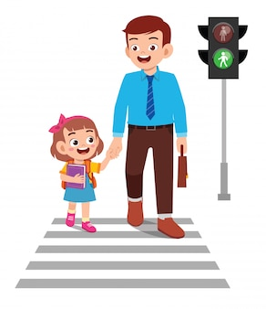 Feliz criança menina bonitinha atravessar a rua com o pai