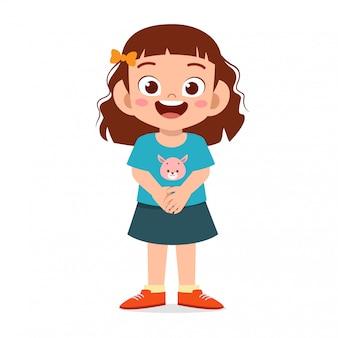 Feliz criança menina bonitinha com gesto de respeito